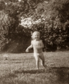 Marie_in_sprinklers_1963_sepia